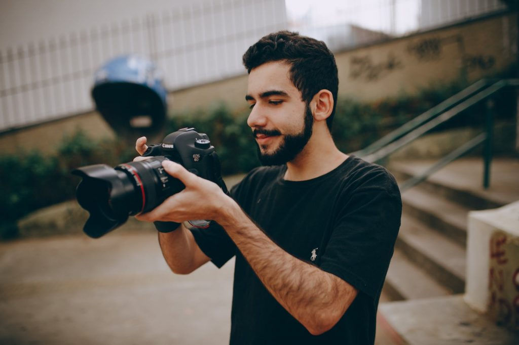 the guy who is taking photos with canon